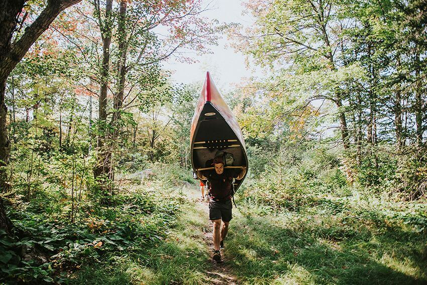 Portaging a canoe in Katahdin Woods & Waters National Monument